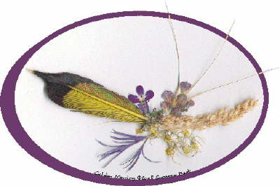 In Golden Morning, the golden underside of a Northern Flicker's dropped feather forms a cradle with Millet, a favored food of the birds. Spikes of Winter Rye extend behind French Lavender petals, from wisps of Cynthia's Thistle. And a single Sapphire Lobelia rests above Creeping Thyme and bits of Basket of Gold.